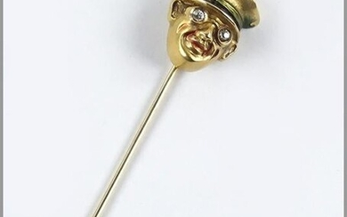 A 14 Karat Yellow Gold Stick Pin.