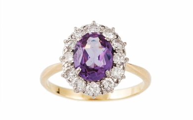 A COLOUR CHANGE SAPPHIRE AND DIAMOND CLUSTER RING, the centr...