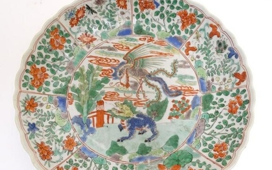 A Chinese plate with a lobed rim and hand painted