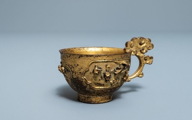 A Chinese relief decorated gilt bronze cup, Ming...