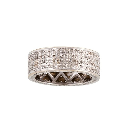 A DIAMOND ETERNITY BAND, set with four rows of brilliant cut...