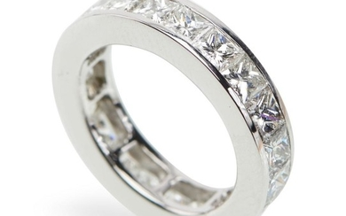 A DIAMOND ETERNITY RING-The full circle ring set with twenty one princess cut diamonds totalling 6.50cts, in 18ct white gold, ring s...