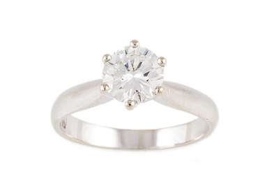A DIAMOND SOLITAIRE RING, the brilliant cut diamonds mounted...