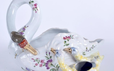 A LATE 19TH CENTURY FRENCH FAIENCE GLAZED SWAN PLANTER