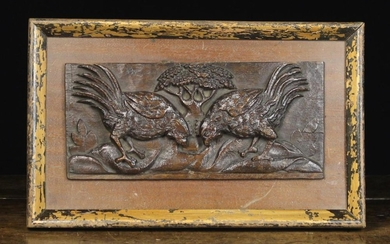 A Late 17th Century Carved Oak Panel depicting two fighting cocks with a tree to the centre distance