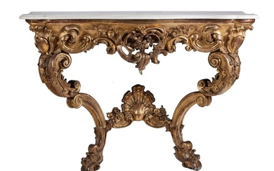 A Louis XV style marble-topped carved giltwood console...