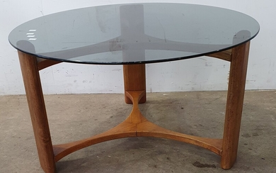 A MID CENTURY ROUND SMOKED GLASS COFFEE TABLE