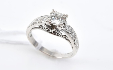 A TRANSITION CUT DIAMOND RING OF 0.60CTS/H/VS1 WITH DIAMOND SET SHOULDERS, SIZE M