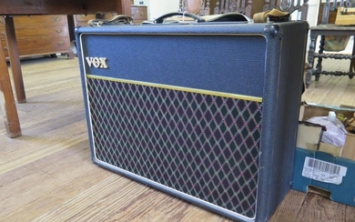 A Vox AC30 amplifier, serial no. 7407D1020, with foot pedal,...