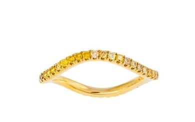 A YELLOW SAPPHIRE ETERNITY RING, wavy design, set with circu...