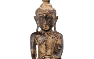 A bronze figure of a sitting Buddha, Shan, Burma, 33 cm high (damages to the stand)