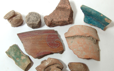 A collection of stone and pottery fragments
