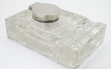 A glass Standish with inkwell and pen rest, the inkwell