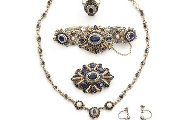 A jewelery set, comprising necklace, bracelet, ring, ear screws and brooch, set with numerous blue glass stones and pearls, mounted in gilt silver. (6)
