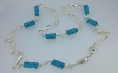 A long necklace of cultured freshwater pearls and