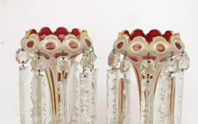 A pair of Bohemian cranberry glass lustres...