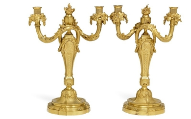 A pair of French Louis XVI style gilt bronze two light candelabra. Late 19th century. H. 36.5 cm. (2)