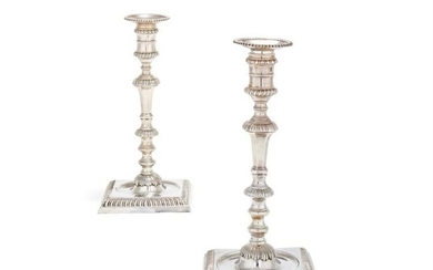 A pair of George II cast silver square candlesticks by John Cafe