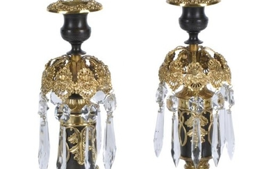 A pair of Regency parcel gilt and lacquered brass and cut glass lustre candlesticks