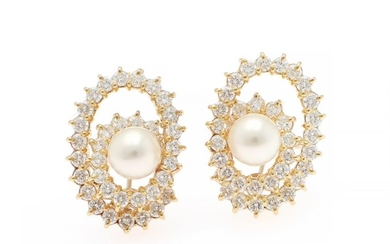 A pair of pearl and diamond ear pendants each set with a pearl and numerous brilliant-cut diamonds, total weight app. 3.50 ct., mounted in 18k gold. (2)