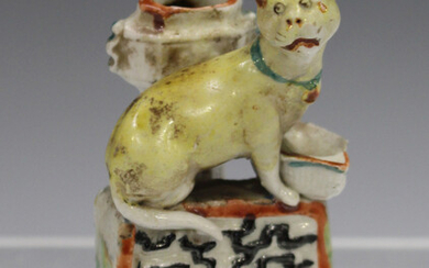 A rare Chinese enamelled blanc-de-Chine porcelain miniature cat jostick holder, Kangxi period, model