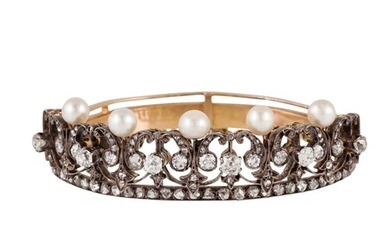 AN ANTIQUE PEARL AND DIAMOND BANGLE, of open worked design,...