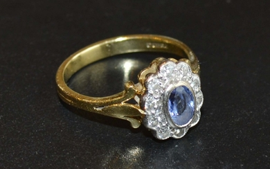 An 18 Carat Gold Tanzanite and Diamond Ring set with an oval...