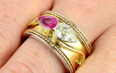 An 18ct gold bi-colour band ring, with pear-shape old-cut diamond and ruby highlights.