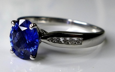 An 18ct white gold, sapphire and diamond dress ring, the dee...