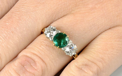 An early 20th century 18ct gold and platinum, Colombian emerald and old-cut diamond three-stone ring.