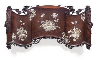 An early 20th century Chinese hardwood and mother of pearl inlaid wall plaque