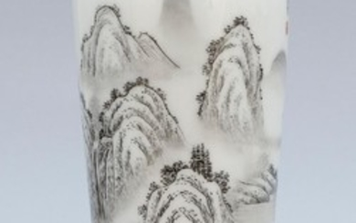 CHINESE EN GRISAILLE PORCELAIN VASE In tapered cylindrical form. Mountainous landscape decoration highlighted by a red temple at the...