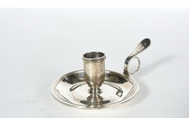 Candlestick in silver, round shape, underlined by threads. Rolling socket....