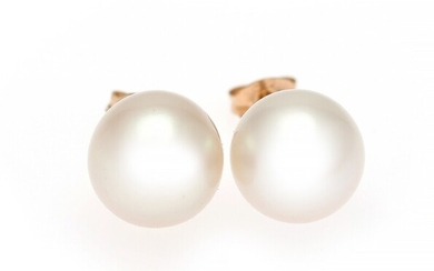 A pair of pearl ear studs each set with a cultured pearl, mounted in 8k...