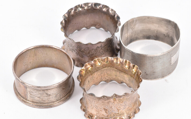 FOUR STERLING SILVER NAPKIN RINGS