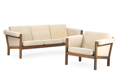 """Hans J. Wegner: """"GE 40"""". Sofa and easy chair of dark stained oak. Sides and cushions upholstered with light wool. Manufactured by Getama. (2)"""