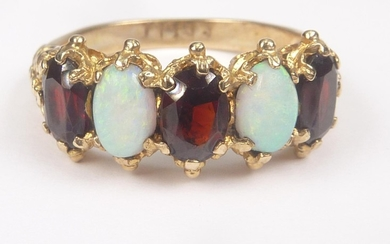 Garnet and opal five stone ring in 9ct gold, 1973. Size 'O½'...