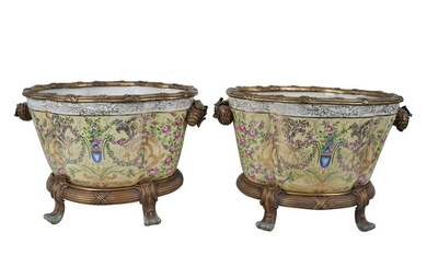 PAIR OF BRONZE-MOUNTED OVAL PORCELAIN PLANTERS