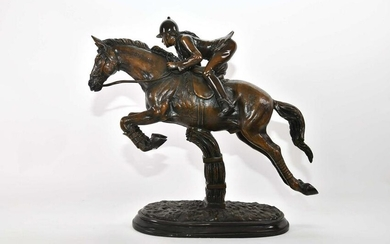 PATINATED BRONZE OF A JUMPING HORSE WITH RIDER
