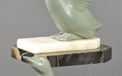 Pair of Art Deco bookends, in patinated metal and