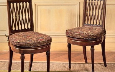 Pair of mahogany moulded and carved chairs, chiselled...
