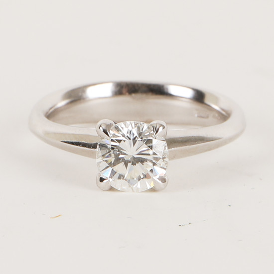 Ring with solitaire brilliant cut diamond about 1.