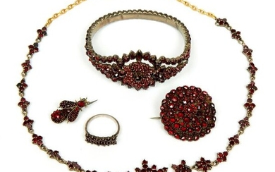 Silver and gold necklace, stiff bracelet, two brooches...