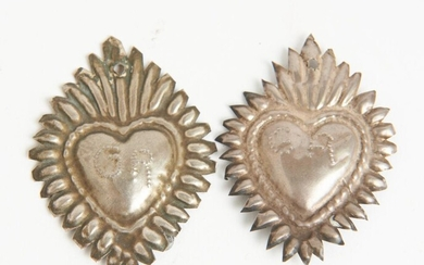TWO EARLY 20TH CENTURY PERUVIAN SILVER RELIGIOUS ICONS (SACRED HEARTS), EMBOSSED INITIALS (GA AND GR), COMPLETE WITH PERUVIAN 'ARTEF...