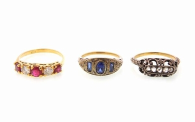 Three yellow and white gold and silver rings with diamonds, rubies and blue stones