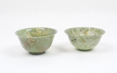 Two Chinese semi-translucent jadeite bowls, of typical form, each with...