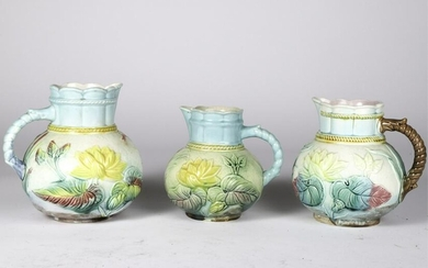 (3) GRADUATING MAJOLICA WATER LILY PITCHERS