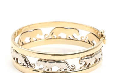 A 14k gold and white gold panther bangle. Inside 5.6×6.4 cm. Weight app. 45 g.