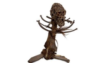 A 19TH CENTURY AFRICAN WITCH DOCTOR STAFF (FETISH) FORMED FROM MONKEY REMAINS