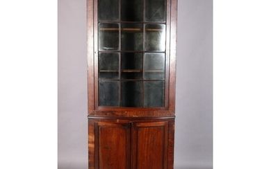 A 19TH CENTURY MAHOGANY BOW FRONT STANDING CORNER CUPBOARD, ...